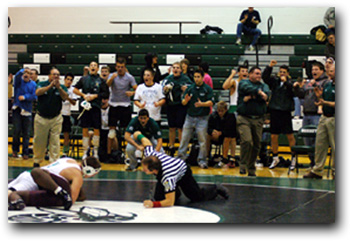 Wrestling team cheering on their teammate!